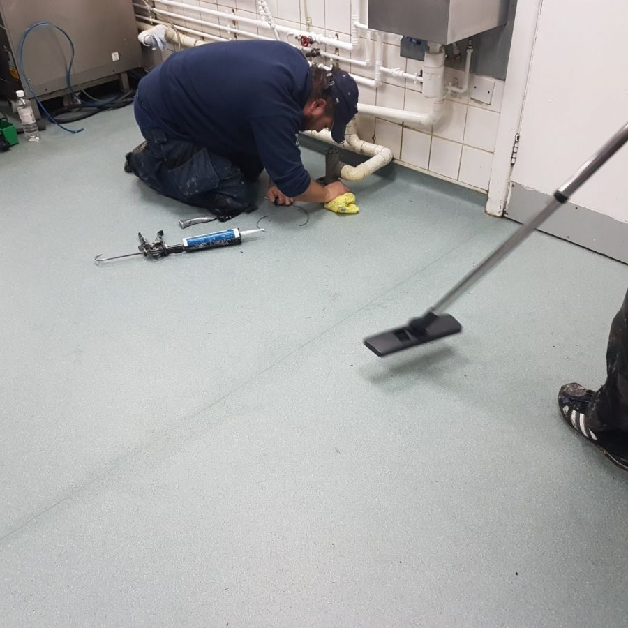 mark cleaning up after installing non slip commercial lino