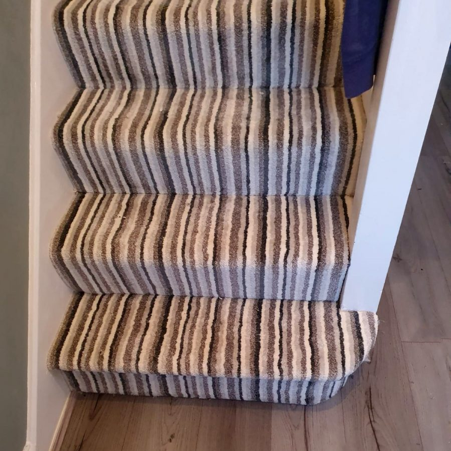 closer image of carpet laid on stairs
